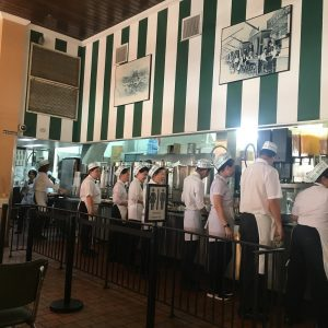 Assembly line of employees at Cafe Du Monde