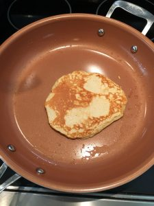 Photo of pancake cooking.