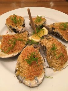 Photo of the Fire Grilled Oysters at R'evolution Restaurant in New Orleans.