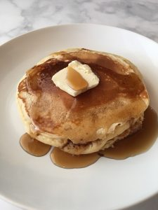 Photo of Old Fashioned Pancakes with butter and syrup.