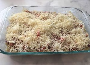 Photo of pasta with shredded mozzarella.
