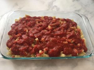 Photo of pasta with tomato sauce.