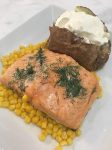 Photo of baked salmon with sides.