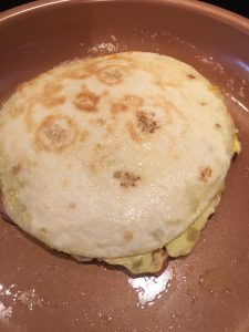 Photo of breakfast quesadilla cooking.