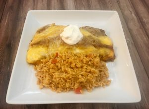 Photo of chicken enchiladas and rice.