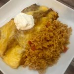 Photo of Chicken Enchiladas with rice.