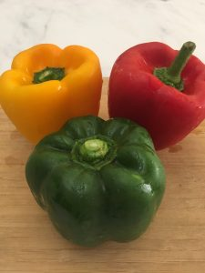 Photo of different colored bell peppers.