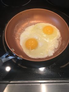 Photo of eggs frying.