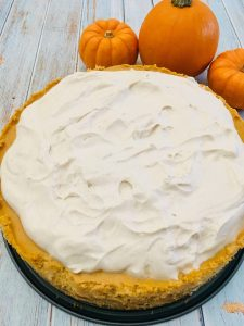 Photo of Pumpkin Cheesecake with Spiced Whipped Cream Frosting.