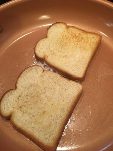 Photo of bread toasted in a pan.