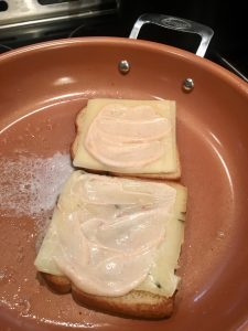Photo of spicy mayo on bread and cheese.