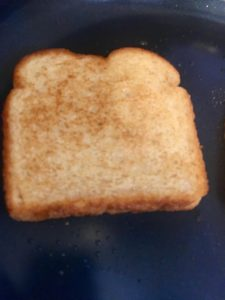 Photo of toasted bread in a pan.