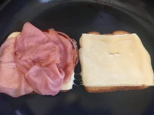 Photo of making grilled ham and cheese sandwiches.