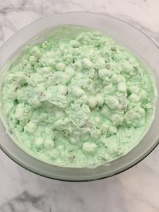 Photo of making of lime jello fluff salad.