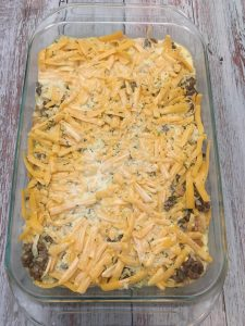 Photo of unbaked sausage and egg breakfast casserole.