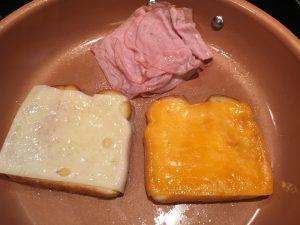 Making a sandwich in a pan.