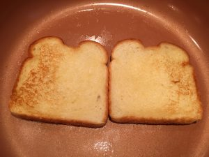 Toasting bread in a pan.
