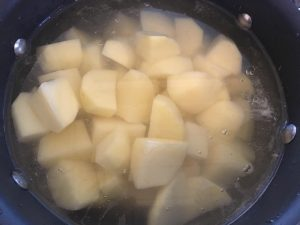 Potatoes in water.