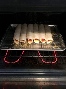 Hot dog quesadillas baking.