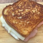Photo of grilled ham and cheese sandwich.